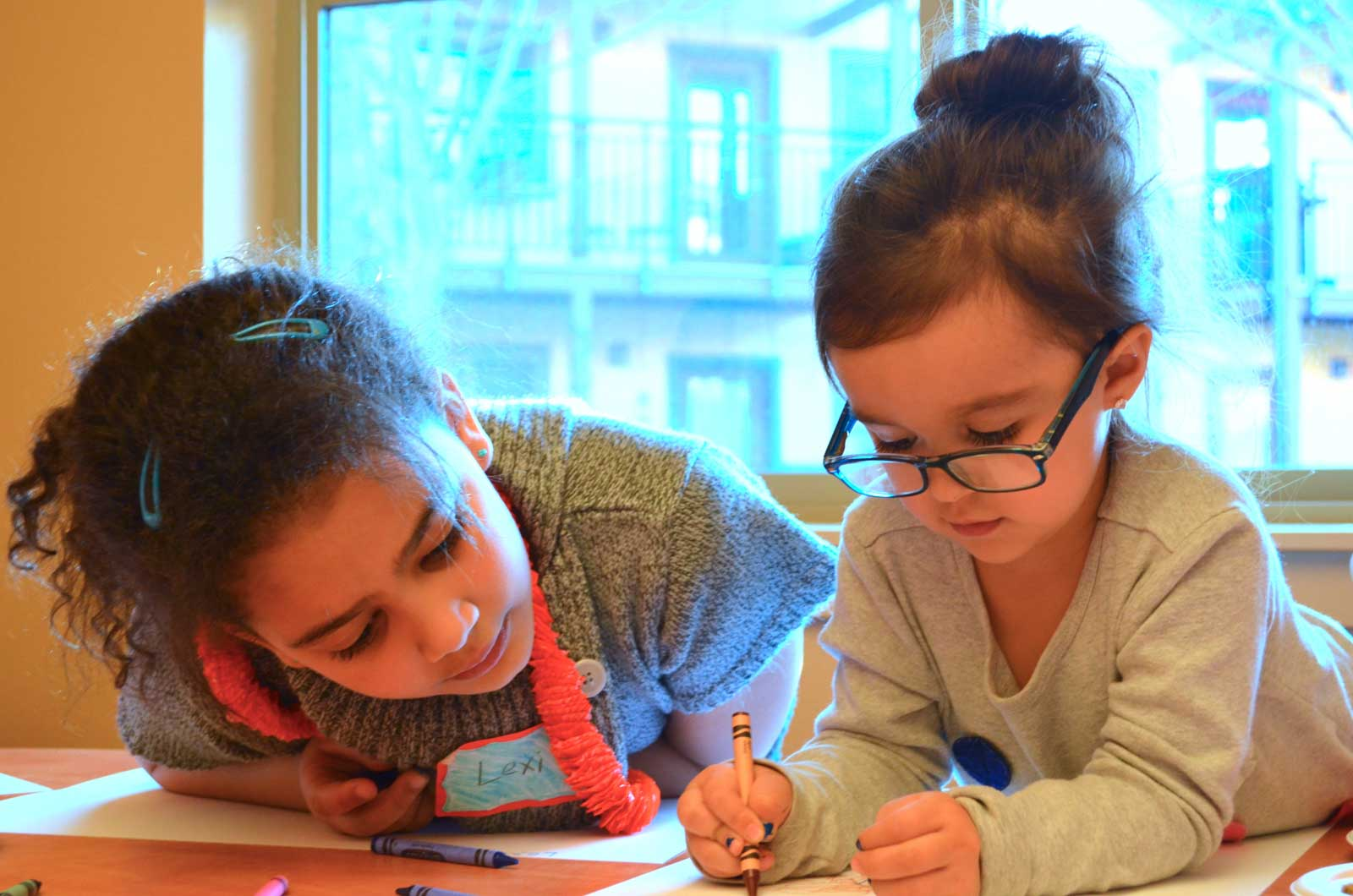 2 girls coloring
